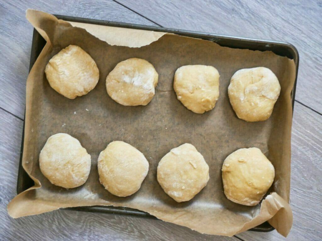 brioche bun dough on baking tray